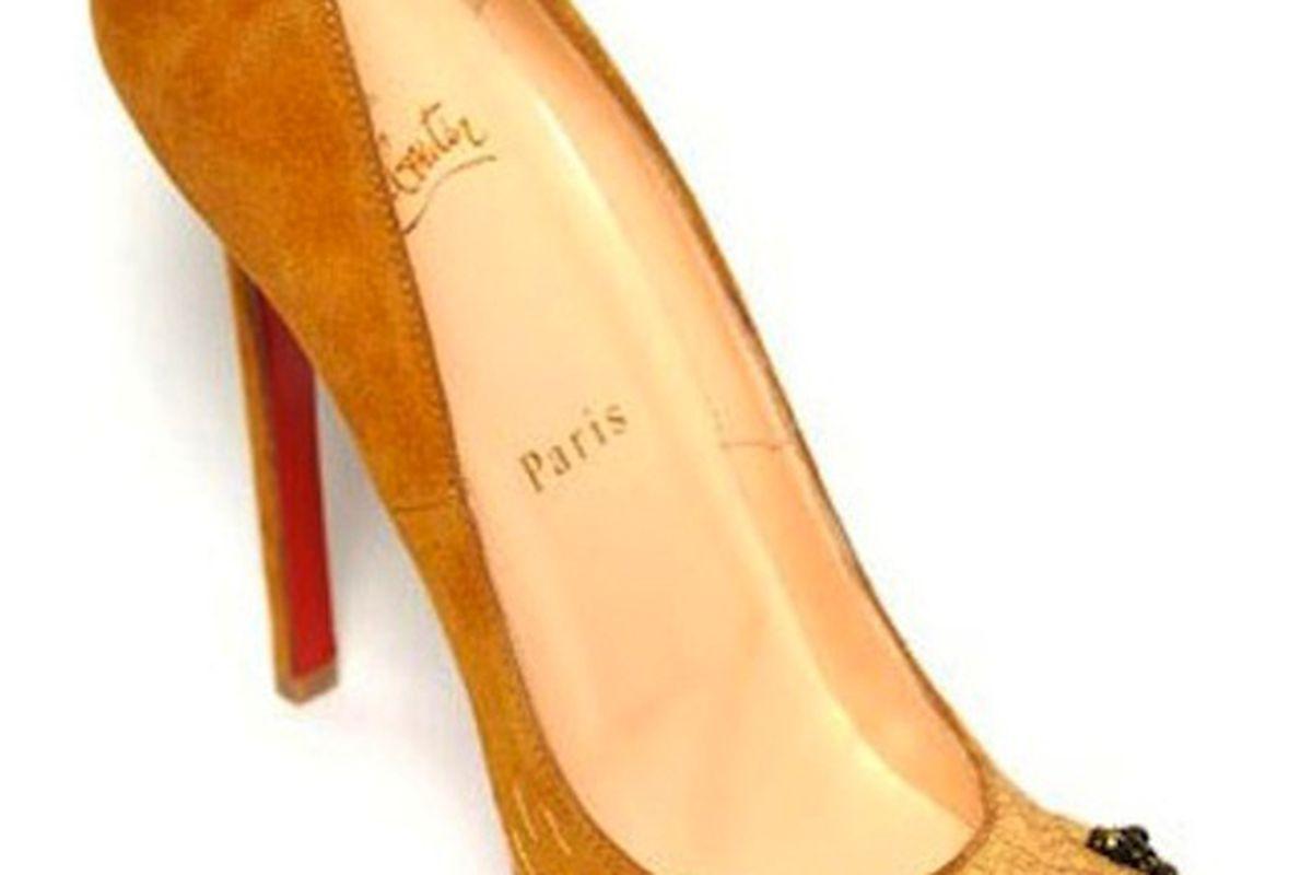 "Umm, kitten heels, anyone? Image via <a href=""http://www.thefrisky.com/post/246-would-you-wear-lion-paw-louboutins/"">The Frisky</a>"