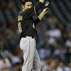Pittsburgh Pirates relief pitcher Hisanori Takahashi reacts after giving up a home run to Houston Astros' Brett Wallace during the seventh inning of a baseball game on Friday, Sept. 21, 2012, in Houston.