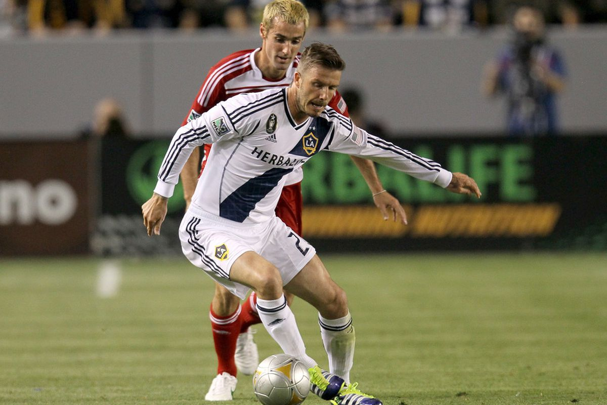 CARSON, CA - APRIL 28:  David Beckham #23 of the Los Angeles Galaxy controls the ball against Andrew Jacobson #4 of FC Dallas at The Home Depot Center on April 28, 2012 in Carson, California.  (Photo by Stephen Dunn/Getty Images)