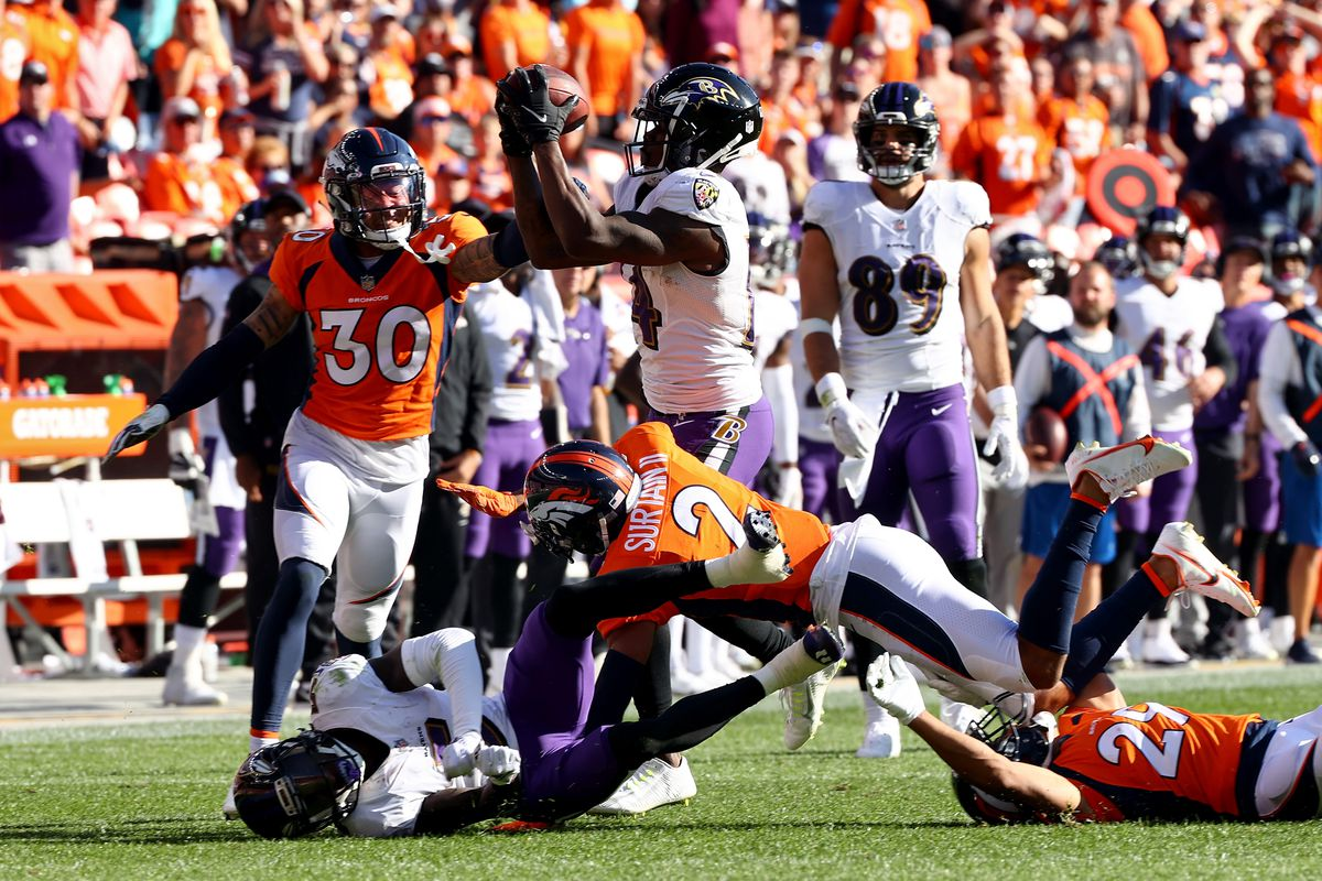 Caden Sterns #30 of the Denver Broncos breaks up the play to Sammy Watkins #14 of the Baltimore Ravens in the second half at Empower Field At Mile High on October 03, 2021 in Denver, Colorado.