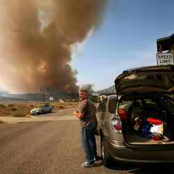 Doug Jepperson responds to an evacuation order from his home at the Lodge at Stillwater near the Jordanelle Reservoir on Saturday, Aug. 18, 2012.
