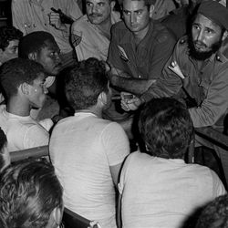 """In this file  photo taken April 18, 1961, Cuba's Prime Minister Fidel Castro speaks with prisoners from the """"Bay of Pigs"""" invasion at the Sports stadium in Havana, Cuba. The Bay of Pigs Invasion was an unsuccessful CIA-sponsored invasion of Cuba by Cuban exiles."""