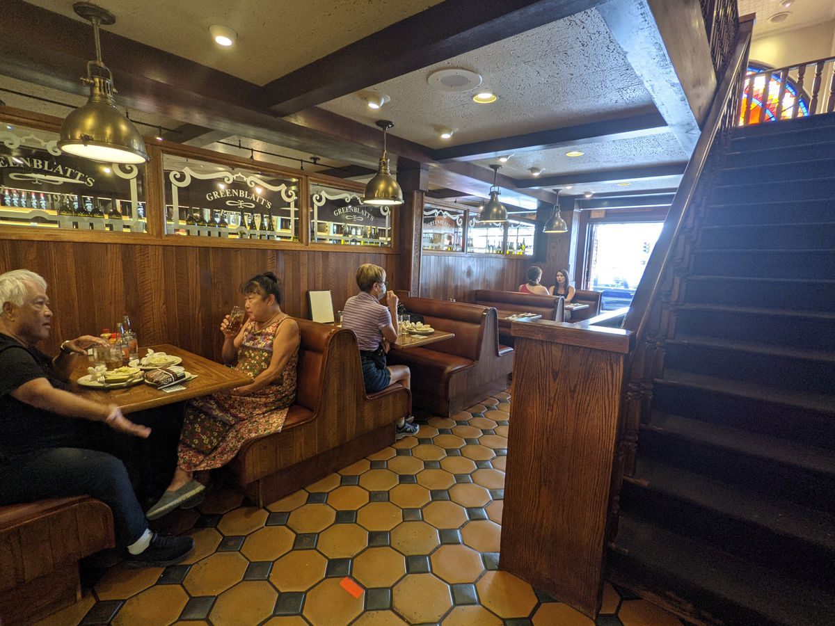 Diners at Greenblatt's Deli's ground floor tables.
