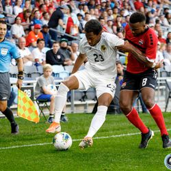 June 18, 2019 - Saint Paul, Minnesota, United States - Trinidad And Tobago midfielder Khaleem Hyland (8) trys to win the ball back as Panama defender Michael Murillo (23) takes the ball to the corner to kill off the game during the Panama vs Trinidad and Tobago match at Allianz Field.