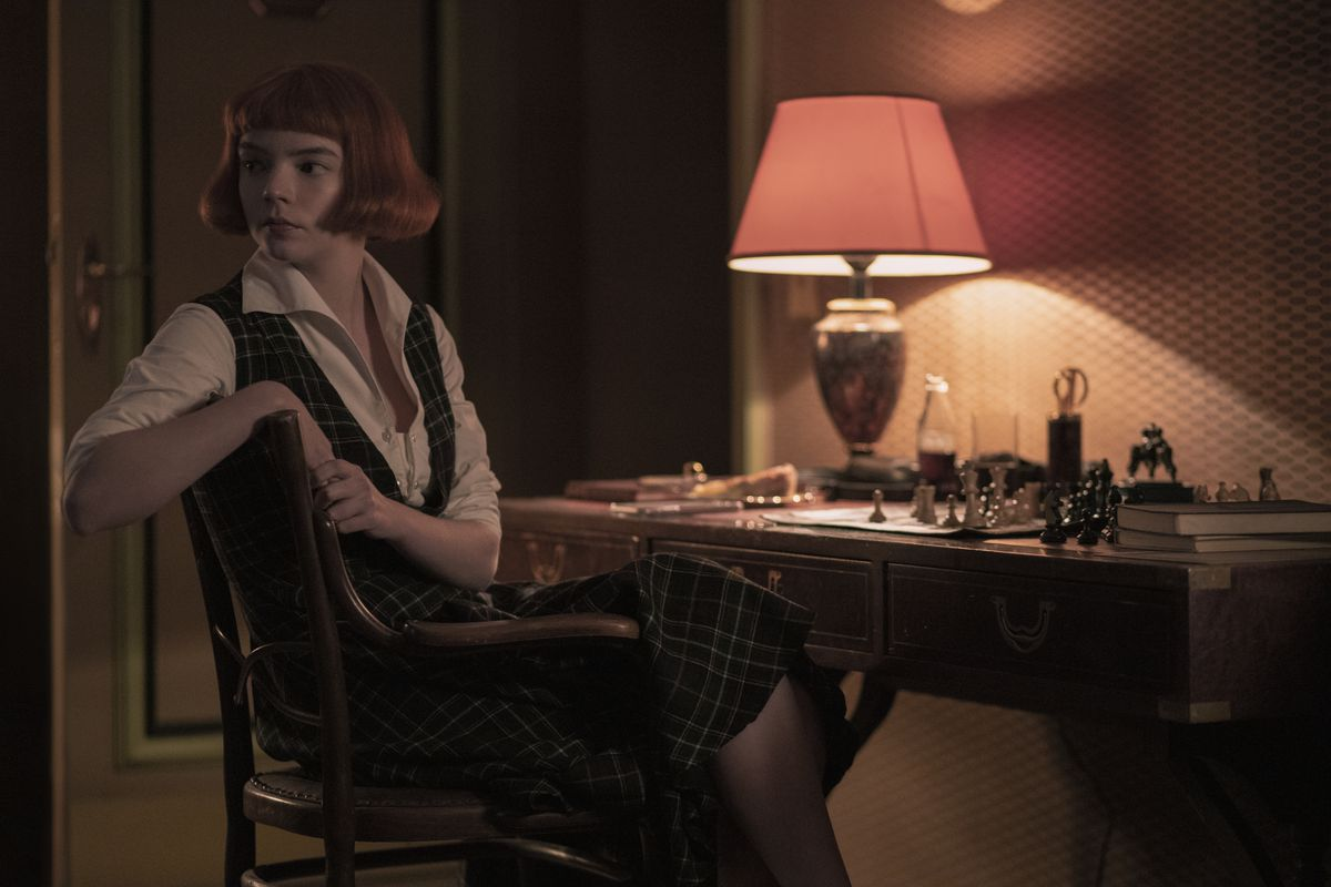 Beth, played by Anya Taylor-Joy, studies a chessboard before a tournament.