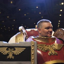 Space Marine Jon Robinson stands on stage during the Salt Lake Comic Con kickoff news conference at the Salt Palace Convention Center in Salt Lake City, Thursday, Sept. 4, 2014.