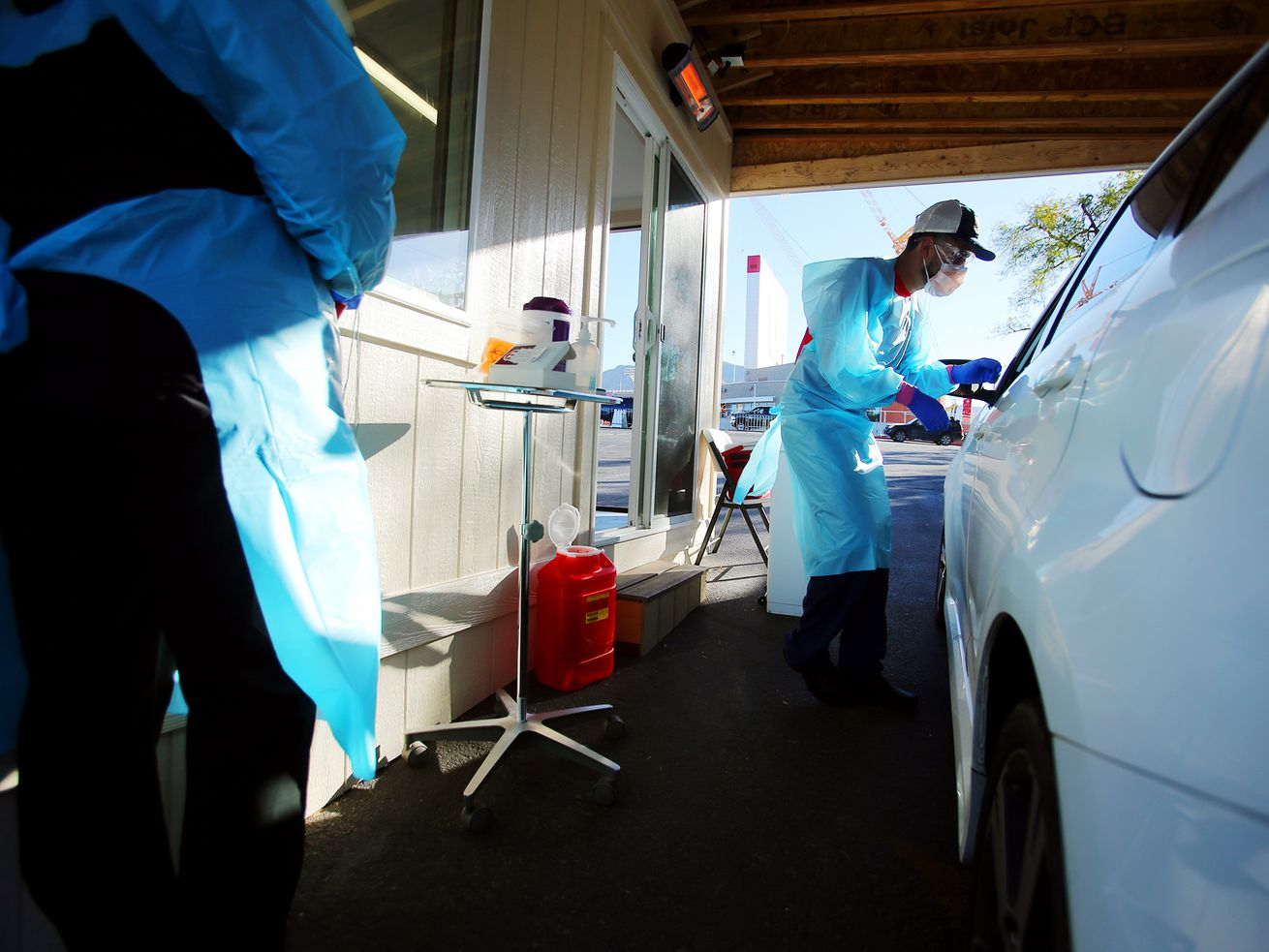 Nurses Polly Crookston and Daniel Salas Jimenez work at a new COVID-19 testing site in the parking lot of Rice-Eccles Stadium in Salt Lake City on Monday, Oct. 12, 2020. The testing site is open Monday through Friday, 8 a.m. to 4 p.m., and Saturday and Sunday, 8 a.m. to noon. Appointments are required.