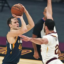 Utah Jazz's Bojan Bogdanovic, left, shoots over Cleveland Cavaliers' Larry Nance Jr. during the first half of an NBA basketball game Tuesday, Jan. 12, 2021, in Cleveland.