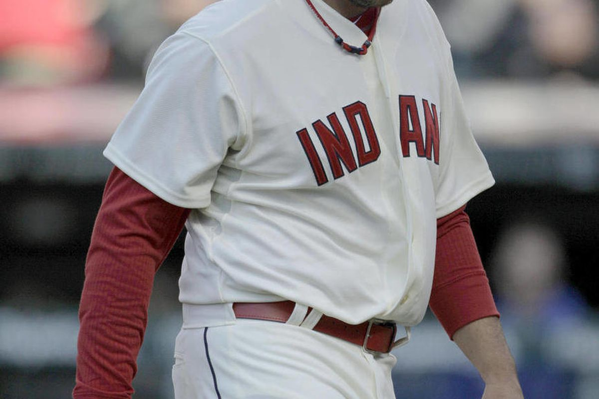 Cleveland Indians relief pitcher Chris Perez walks to the dugout after being pulled from the game after losing a three-run lead in the ninth inning against the Toronto Blue Jays in an Opening Day baseball game in Cleveland on Thursday, April 5, 2012.