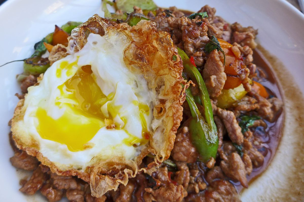 A fried egg on top of coarsely ground pork with a chile here and there.