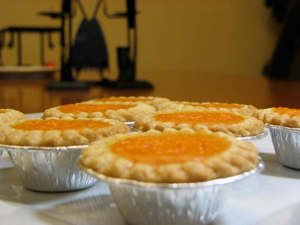 A view of sweet potato pies lined up in tins