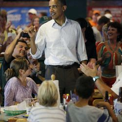 President Barack Obama greets patrons during an unschedule stop at Gator's Dockside, Saturday, Sept. 8, 2012, in Orlando, Fla.