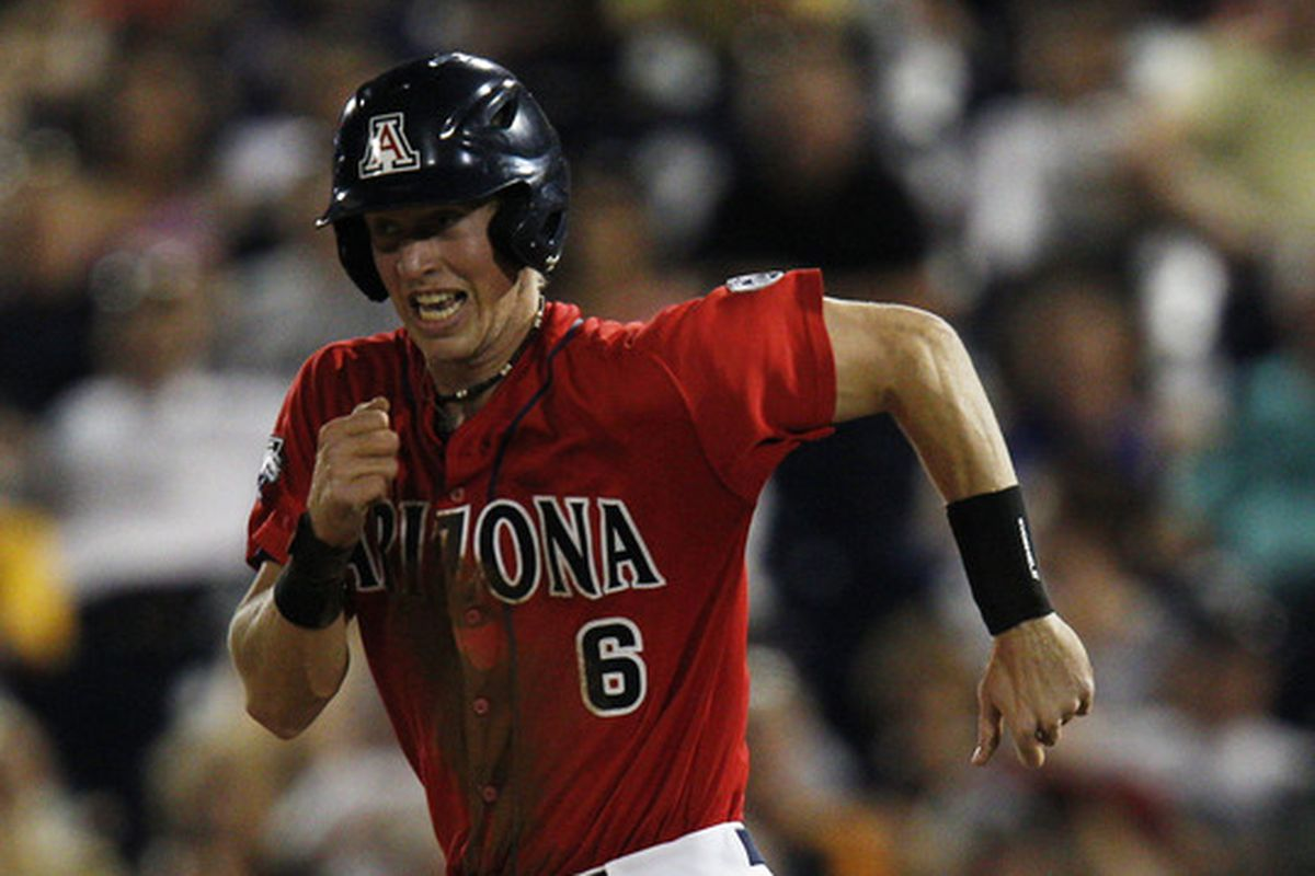 Riley Moore hit a grand slam on Sunday for his first home run of the season as the Arizona Wildcats lost to the Stanford Cardinal 12-8