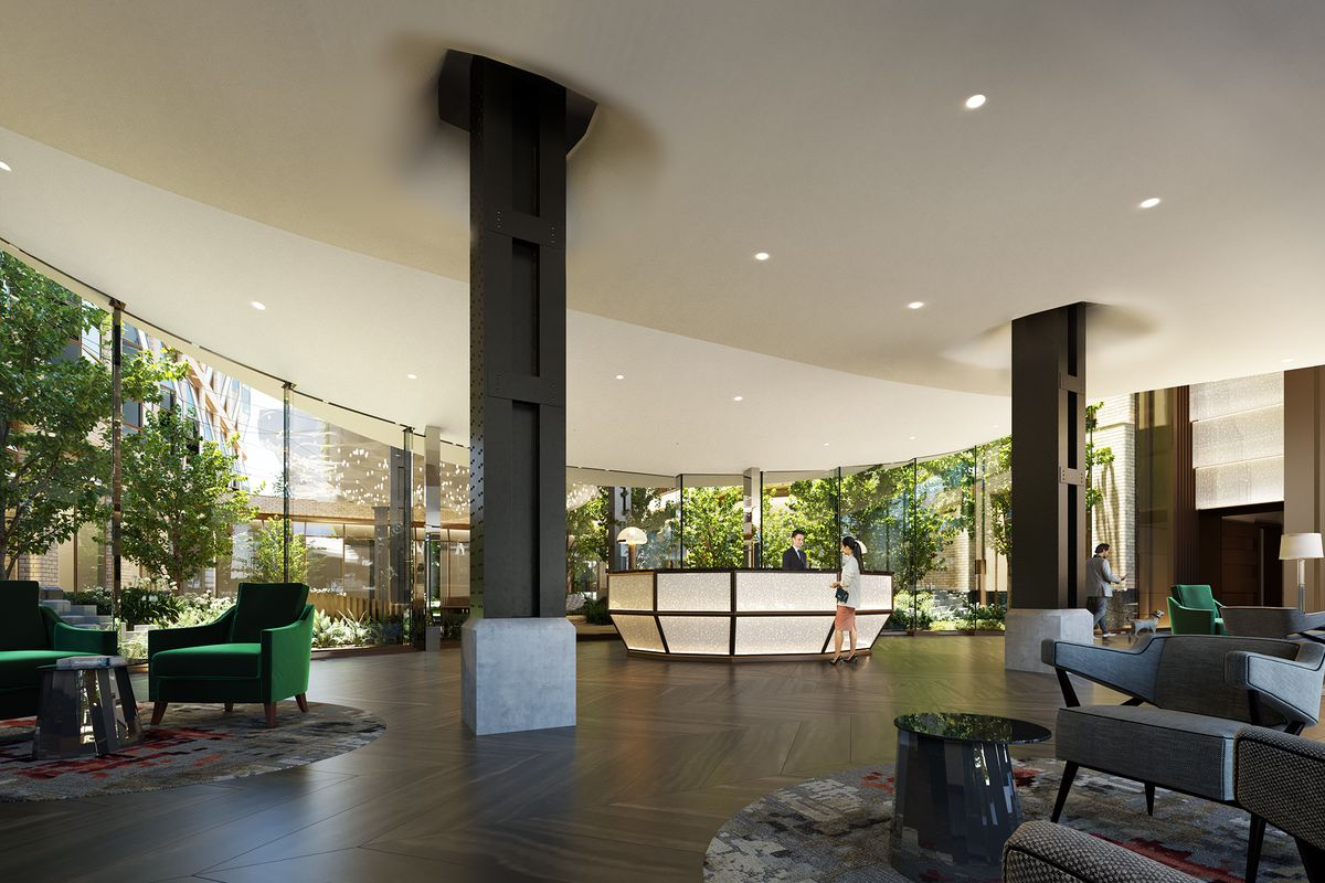 Inside the lobby of Lantern House, where the High Line's steel supports frame the reception desk.