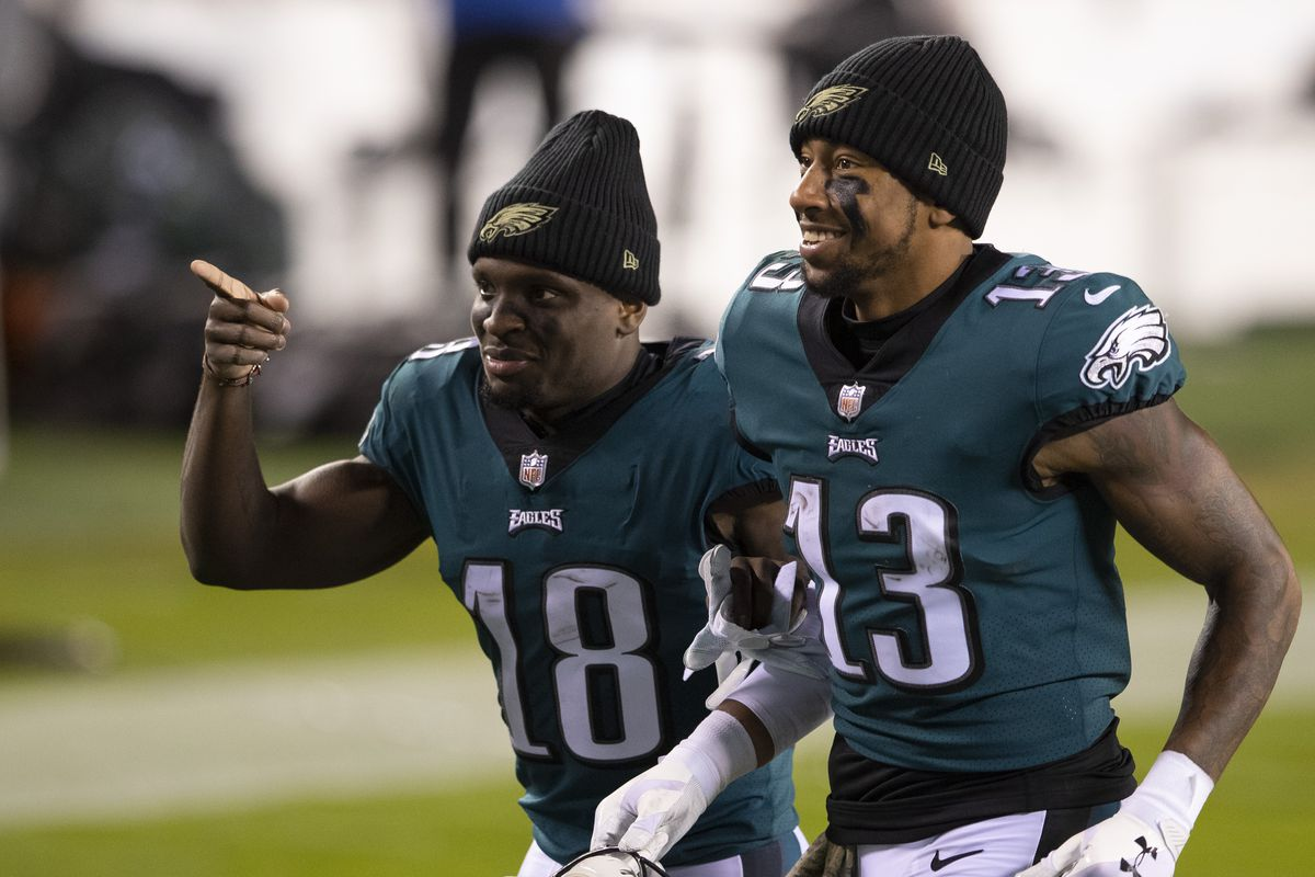 Jalen Reagor #18 and Travis Fulgham #13 of the Philadelphia Eagles run off the field after the game against the Dallas Cowboys at Lincoln Financial Field on November 1, 2020 in Philadelphia, Pennsylvania.