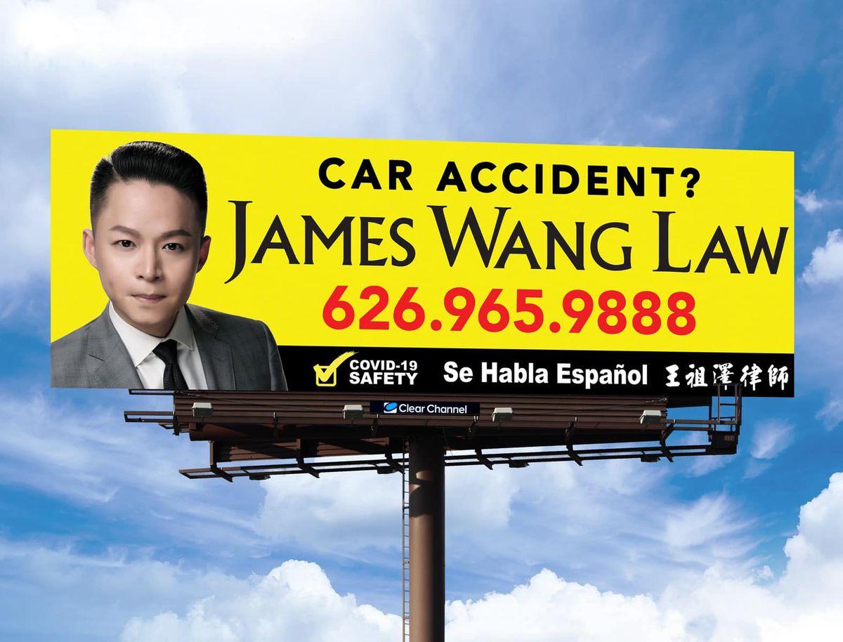 A freeway billboard featuring attorney James Wang.