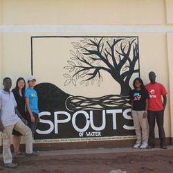 Kathy Ku and fellow Harvard classmates who founded SPOUTS stand outside their factory in Uganda.