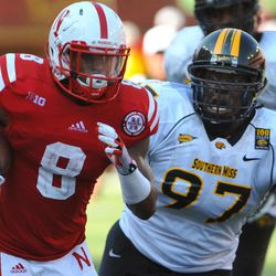 Southern Miss's Rakeem Nunez-Roches (97) tries to run down Nebraska's Ameer Abdullah (8) during an NCAA college football game, Saturday, Sept 1, 2012,  in Lincoln, Neb.