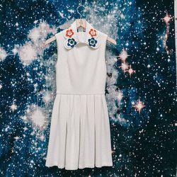 "Vivetta flower collar, <a href=""http://americantwoshot.com/vivetta-flowers-collar"">$195</a>; Clothes 'Lawrence' white waffle dress, <a href=""http://americantwoshot.com/clothes-lawrence-white-waffle-dress"">$198</a>"