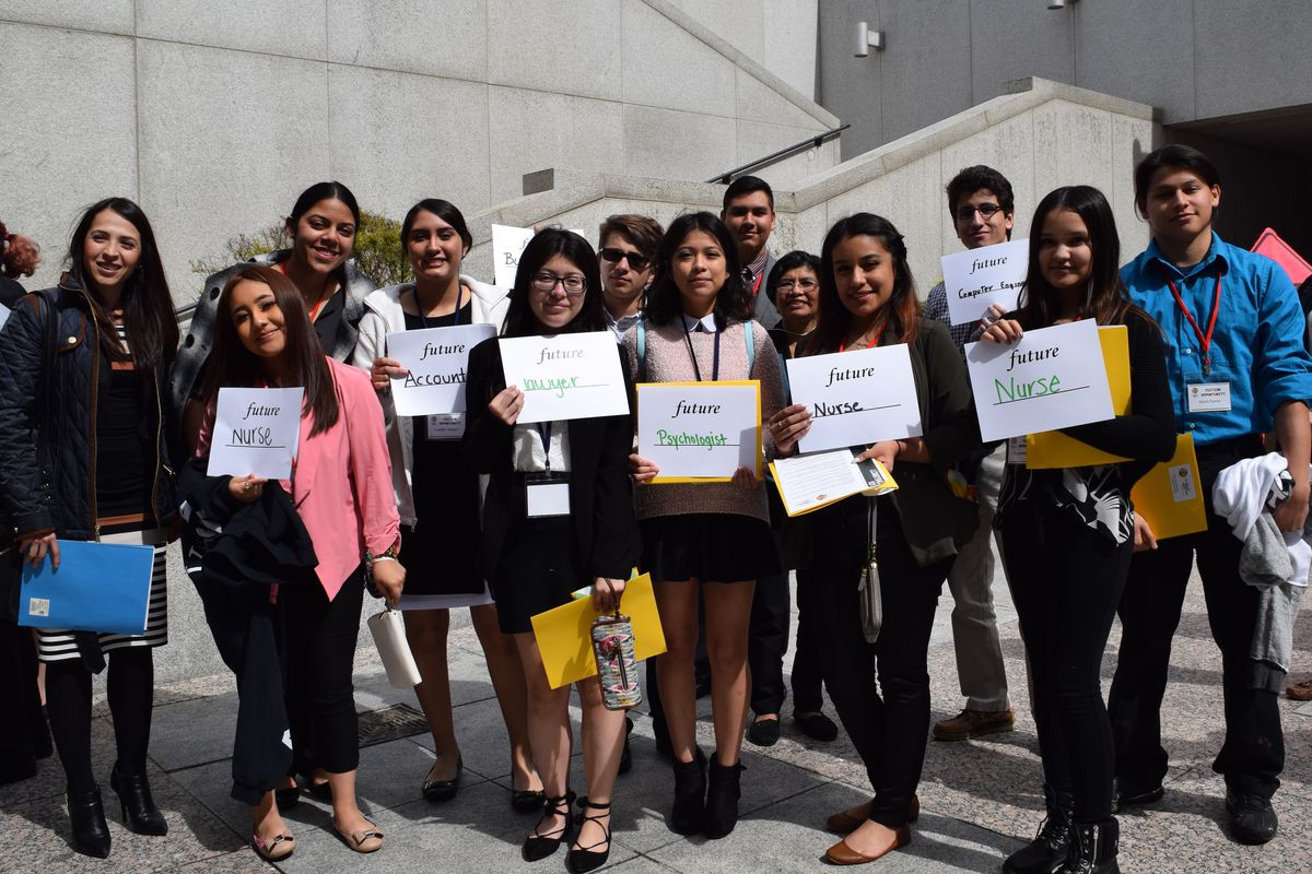Immigrant students display their career aspirations during a visit to the State Capitol in March to support an unsuccessful bill that would have extended in-state tuition to them.