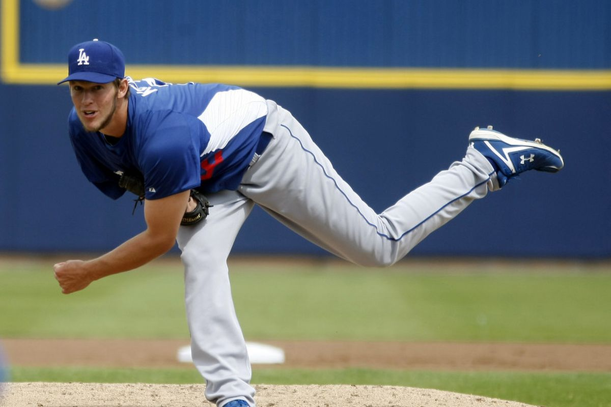 March 25, 2012; Phoenix, AZ, USA; Los Angeles Dodgers starting pitcher Clayton Kershaw (22) throws against the Milwaukee Brewers in the first inning at Maryvale Baseball Park.  Mandatory Credit: Rick Scuteri-US PRESSWIRE