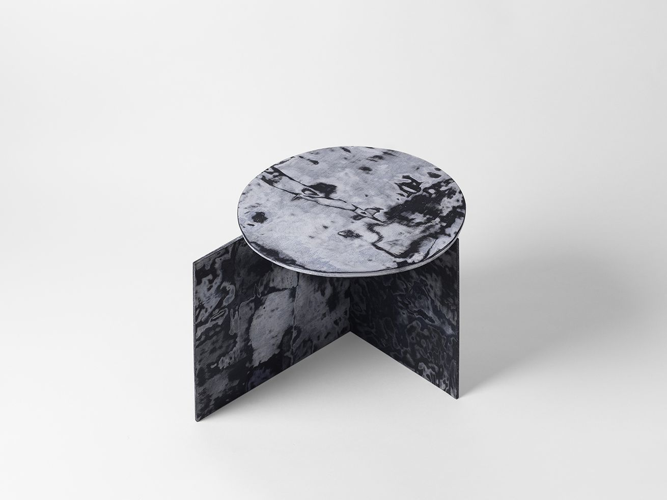 These marble-like tables are made from recycled jeans