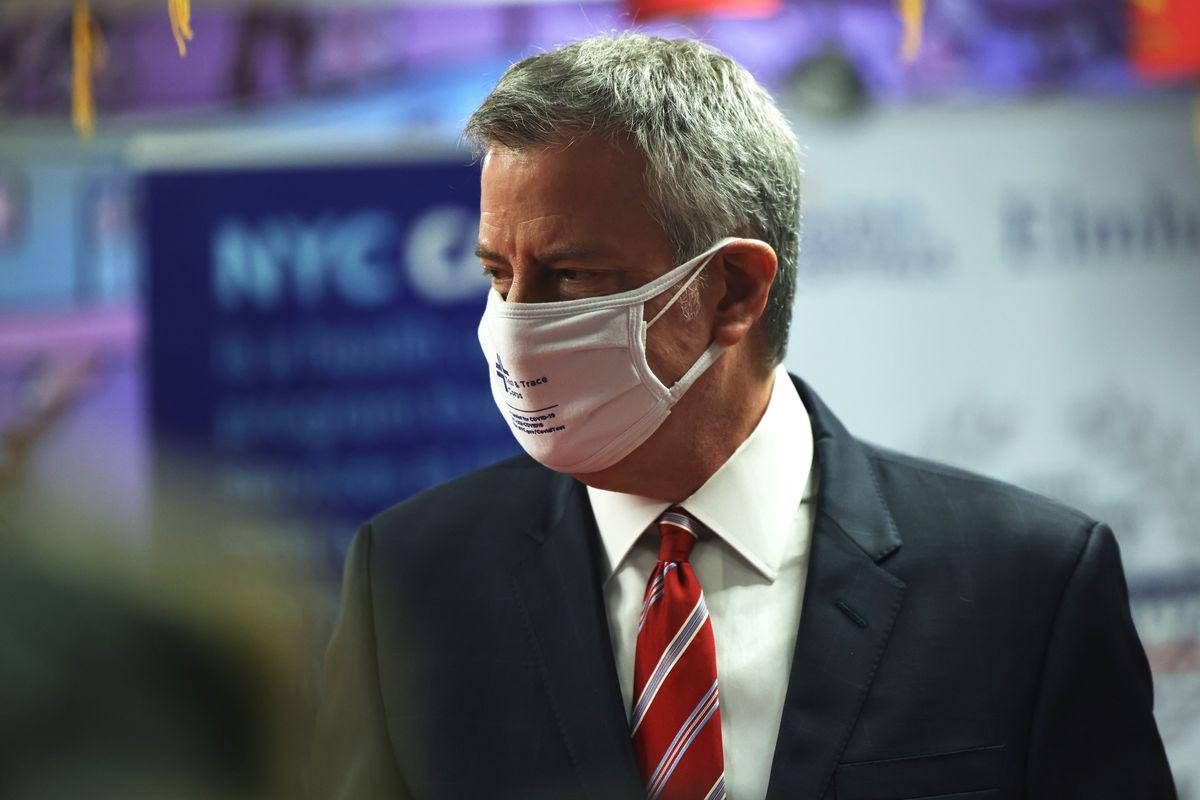 New York City Mayor Bill de Blasio helps to distribute food in the Elmhurst neighborhood of Queens borough on February 19, 2021 in New York City.