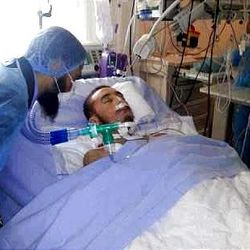 In this undated handout photo released by the family of Omran Shaaban, Shaaban receives treatment from a doctor at a hospital in France. Less than a year after helping drag Moammar Gadhafi from a drainage ditch, a 22-year-old former rebel was captured by the slain leader's supporters who beat, cut and killed him, his family says. The death of Omran Shabaan has brought calls for revenge and highlights the challenges facing Libya _ pockets of support for the deposed regime, the new government's inability to rein in militias and the potential for violence like the killing of the U.S. ambassador. (AP Photo, Family of Omran Shaaban)