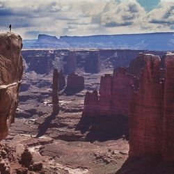 A hiker looks down at White Rim Trail in Canyonlands National Park, Monument Basin. There has been debate on whether recreation areas and national parks in Utah should be opened and run by the state during the federal government shutdown.