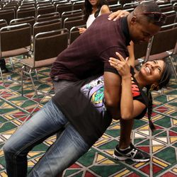"""Walter Jones, from """"The Mighty Morphin' Power Rangers,"""" dances with Marilei Puentes during a press conference at Utah's first Comic Con at the Salt Palace Convention Center in Salt Lake City on Thursday, Sept. 5, 2013."""