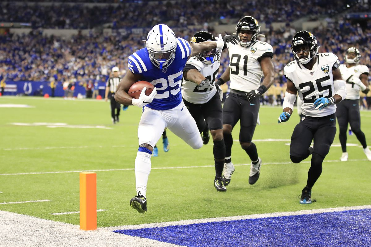 Marlon Mack of the Indianapolis Colts runs for a touchdown during the game against the Jacksonville Jaguars at Lucas Oil Stadium on November 17, 2019 in Indianapolis, Indiana.