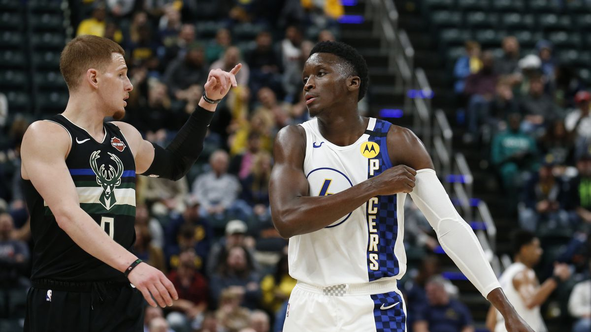 Milwaukee Bucks guard Donte DiVincenzo talks with Indiana Pacers Victor Oladipo during the fourth quarter at Bankers Life Fieldhouse.