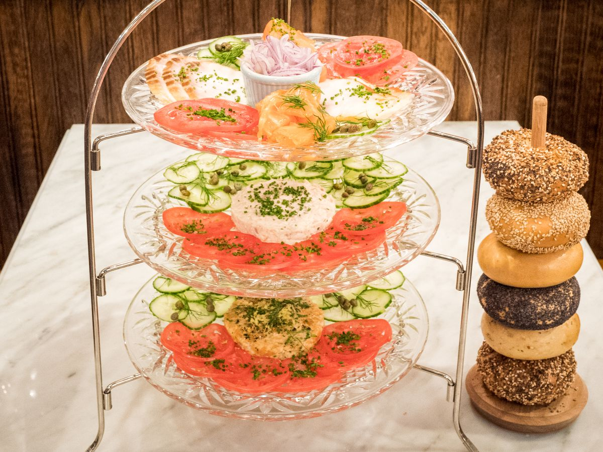 A tower with smoked salmon next to a tower of bagels