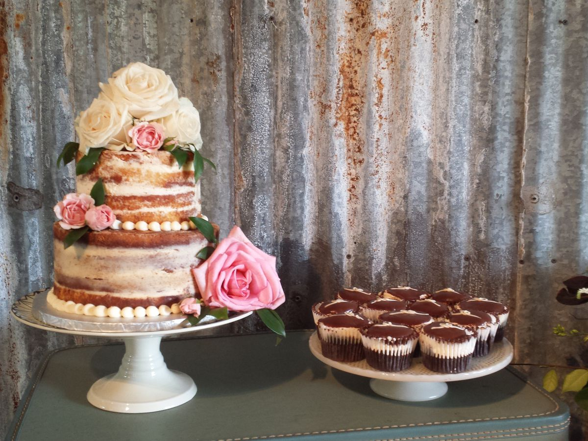 A wedding cake and wedding cupcakes from Sugar Mama's