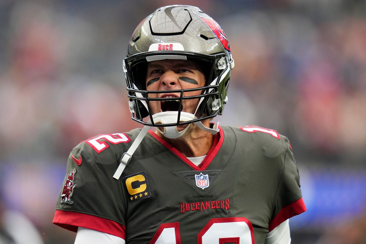 Tampa Bay Buccaneers quarterback Tom Brady (12) yells at Bucs fans as he takes the field for pregame warmups before playing the Los Angeles Rams.