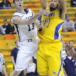 Utah State guard Preston Medlin (13), passes the ball around Cal State Bakersfield forward Adam Young (21) during a college basketball game in the CollegeInsider.com tournament, Wednesday, March 14, 2012, in Logan.
