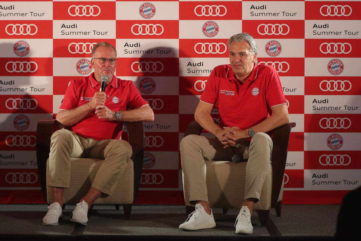 MIAMI, FL - JULY 29: Karl-Heinz Rummenigge (C), CEO of FC Bayern München, and Jörg Wacker (R), head of internationalisation and strategy of FC Bayern, address a news conference during the last day of the FC Bayern AUDI Summer Tour on July 29, 2018 at Mandarin Oriental hotel in Miami, Florida.