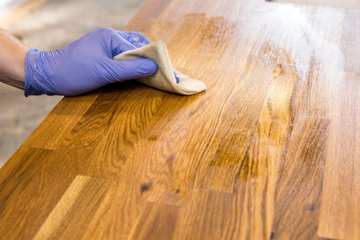 Oiling a wood countertop.