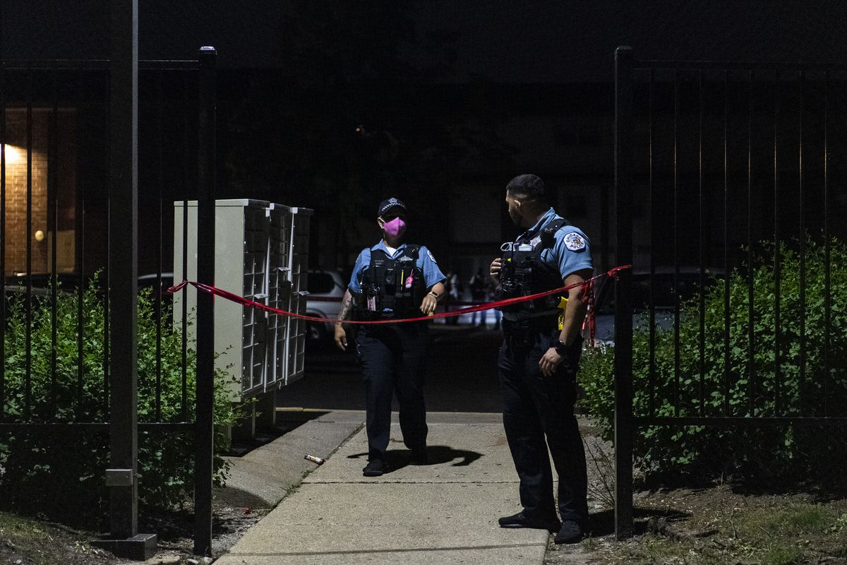 Chicago police investigate the scene where multiple people were shot, including a 9-year-old girl, June 17, 2020, in Gresham on the South Side.
