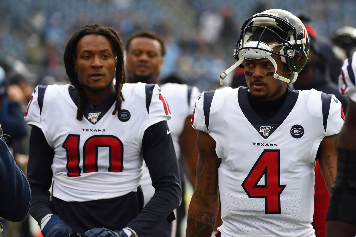 Houston Texans quarterback Deshaun Watson and Houston Texans wide receiver DeAndre Hopkins walk off the field after warmups before the game against the Tennessee Titans at Nissan Stadium.