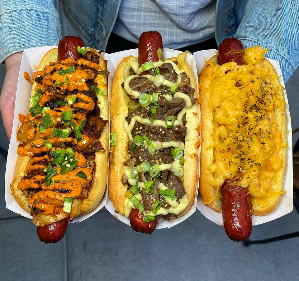 A trio of gourmet hot dogs at Buldogis, including pork, beef and mac & cheese choices.