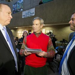 State Sen. Jim Dabakis and his husband, Stephen Justesen, are married by Salt Lake City Mayor Ralph Becker as hundreds turn out to obtain marriage licenses Friday, Dec. 20, 2013 in the Salt Lake County offices after a Federal judge ruled that Amendment 3, Utah's same-sex marriage ban is unconstitutional.