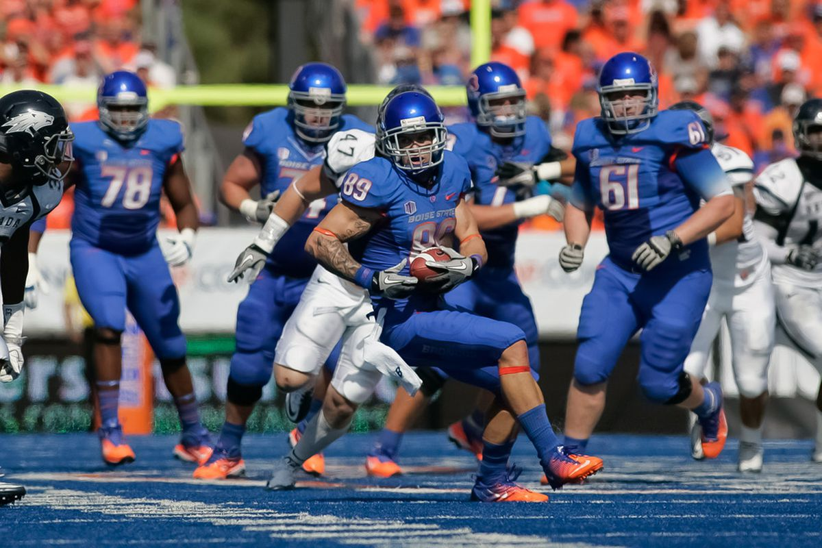 BOISE, ID - OCTOBER 01:  Tyler Shoemaker #89 of the Boise State Broncos runs the ball against the Nevada Wolf Pack at Bronco Stadium on October 1, 2011 in Boise, Idaho.  (Photo by Otto Kitsinger III/Getty Images)