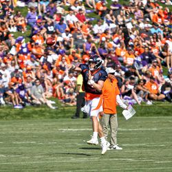 Broncos QB Case Keenum throws a pass on the run during training camp.
