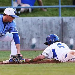 Peasant Grove's Matthew Wilde tries to tag Bingham's Kade Cloward at third base as Bingham and Pleasant Grove play Wednesday, May 21, 2014 in a 5A one-loss bracket game at Kearns.