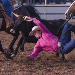 Cole Jensen leaps from the safety of his horse to wrestle a steer during the Utah High School Rodeo Finals in Heber City on Saturday, June 3, 2017.