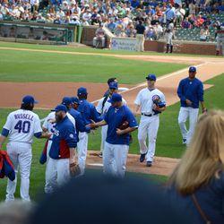 3:05 p.m. Cubs bullpen staff going out to the bullpen -