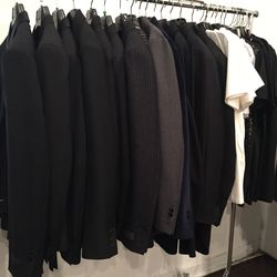 Men's apparel; black blazer, $776.50 (from $3,066) and white tee shirt, $65 (from $260)