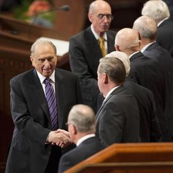 President Thomas S Monson shakes hands with members of the Twelve following the 183rd Semiannual General Conference for the Church of Jesus Christ of Latter-day Saints Sunday, Oct. 6, 2013 inside the Conference Center.