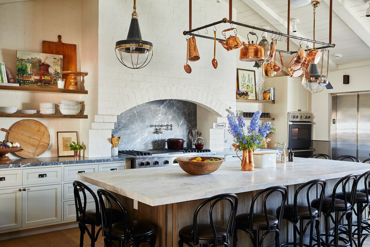 A French cooking school room with an open hearth and Viking oven.